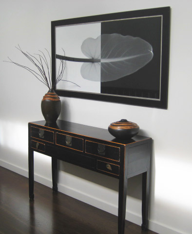 Hall table with art