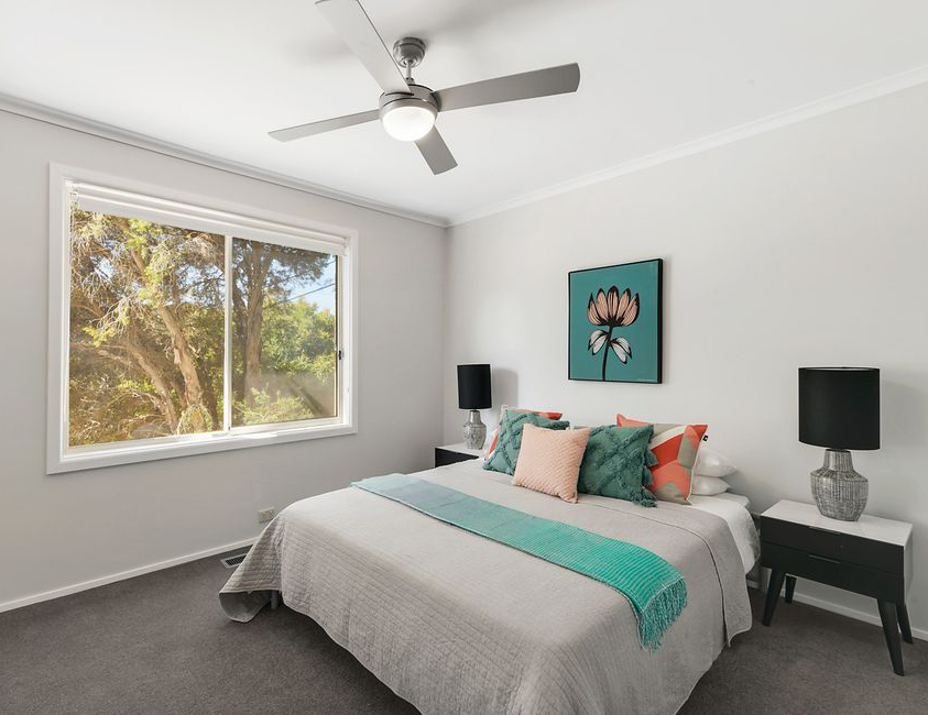Styled bedroom with aqua accents - Melbourne Property Styling - Leeder Interiors