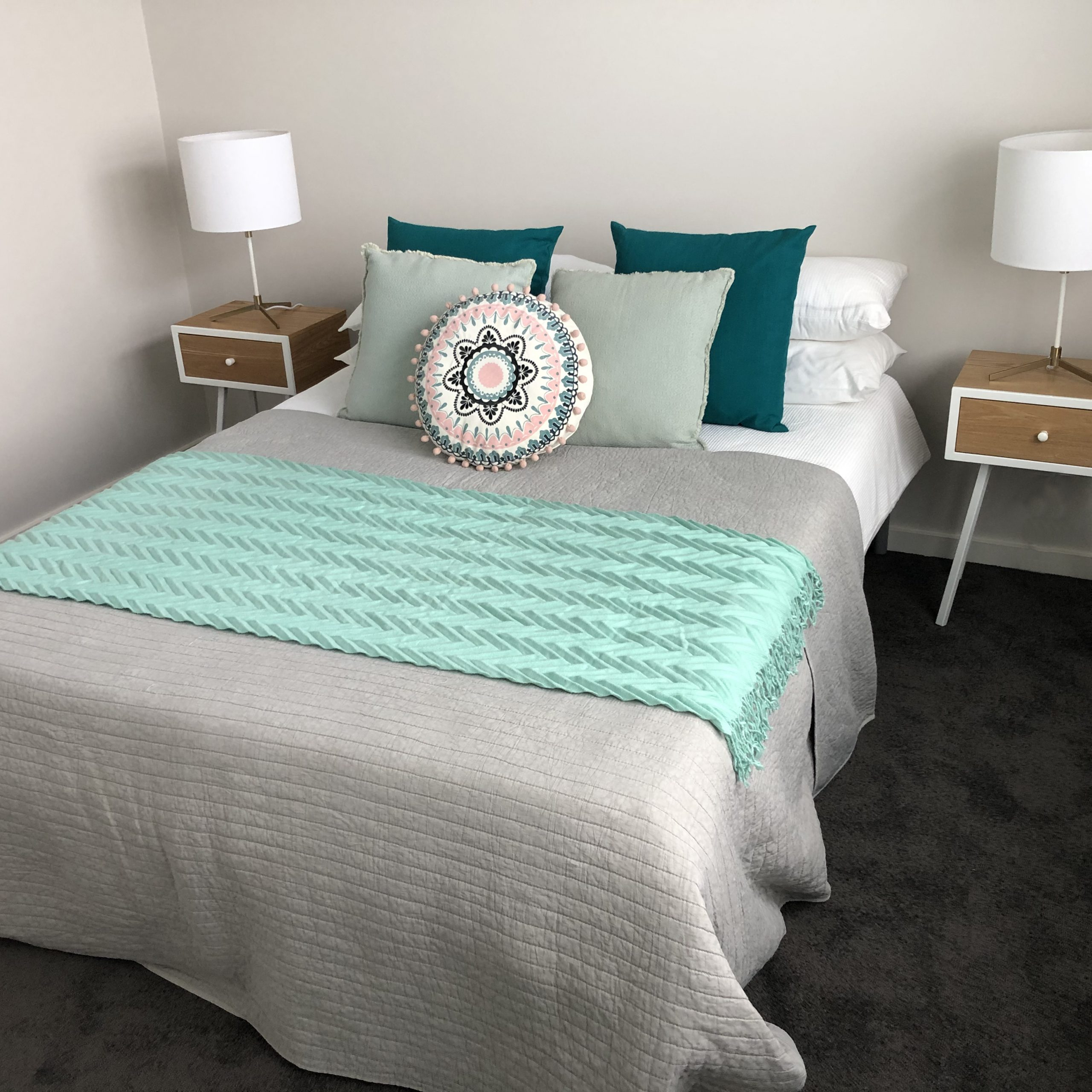Styled bedroom with aqua accents