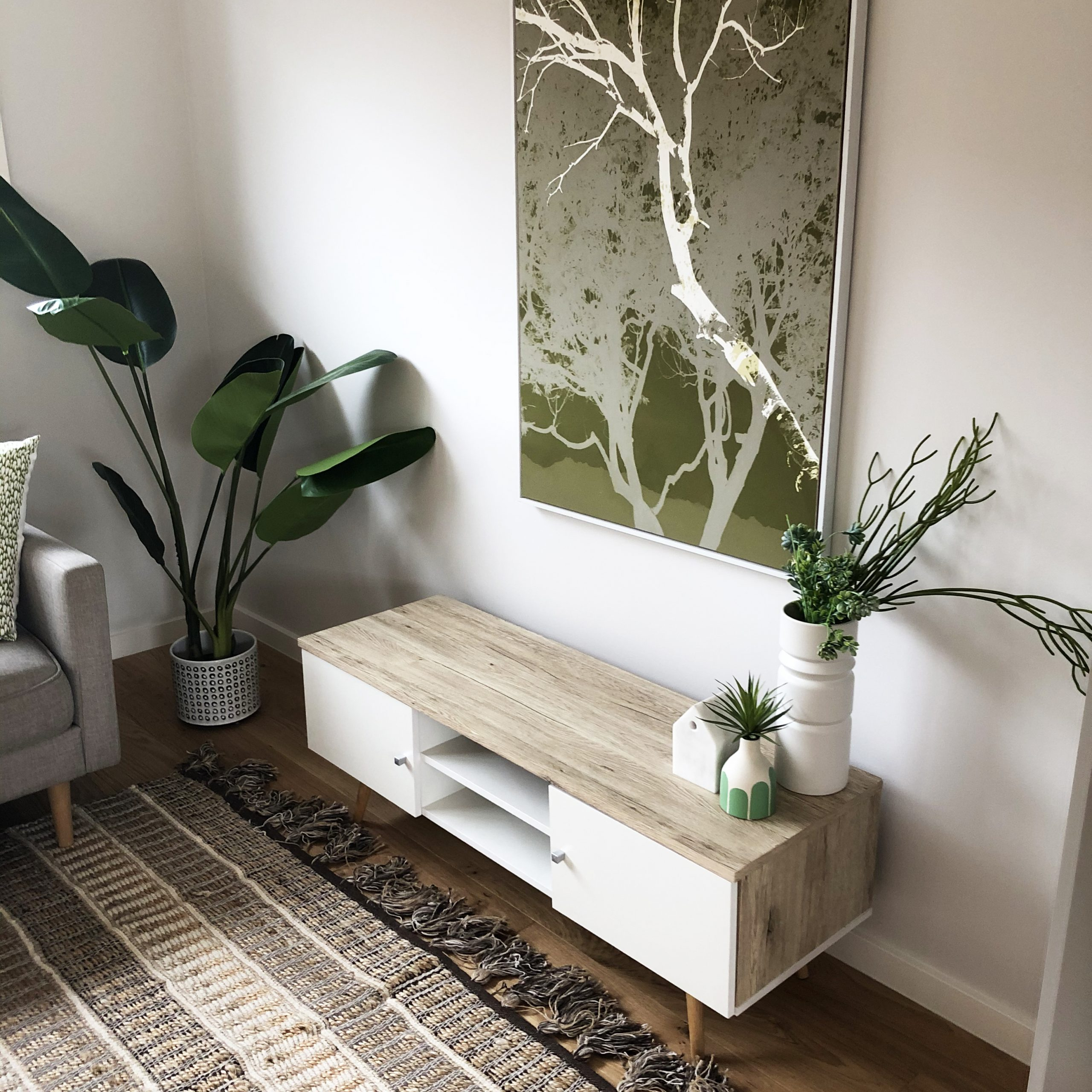 Styled living space with green artwork - Melbourne Home Staging - Leeder Interiors