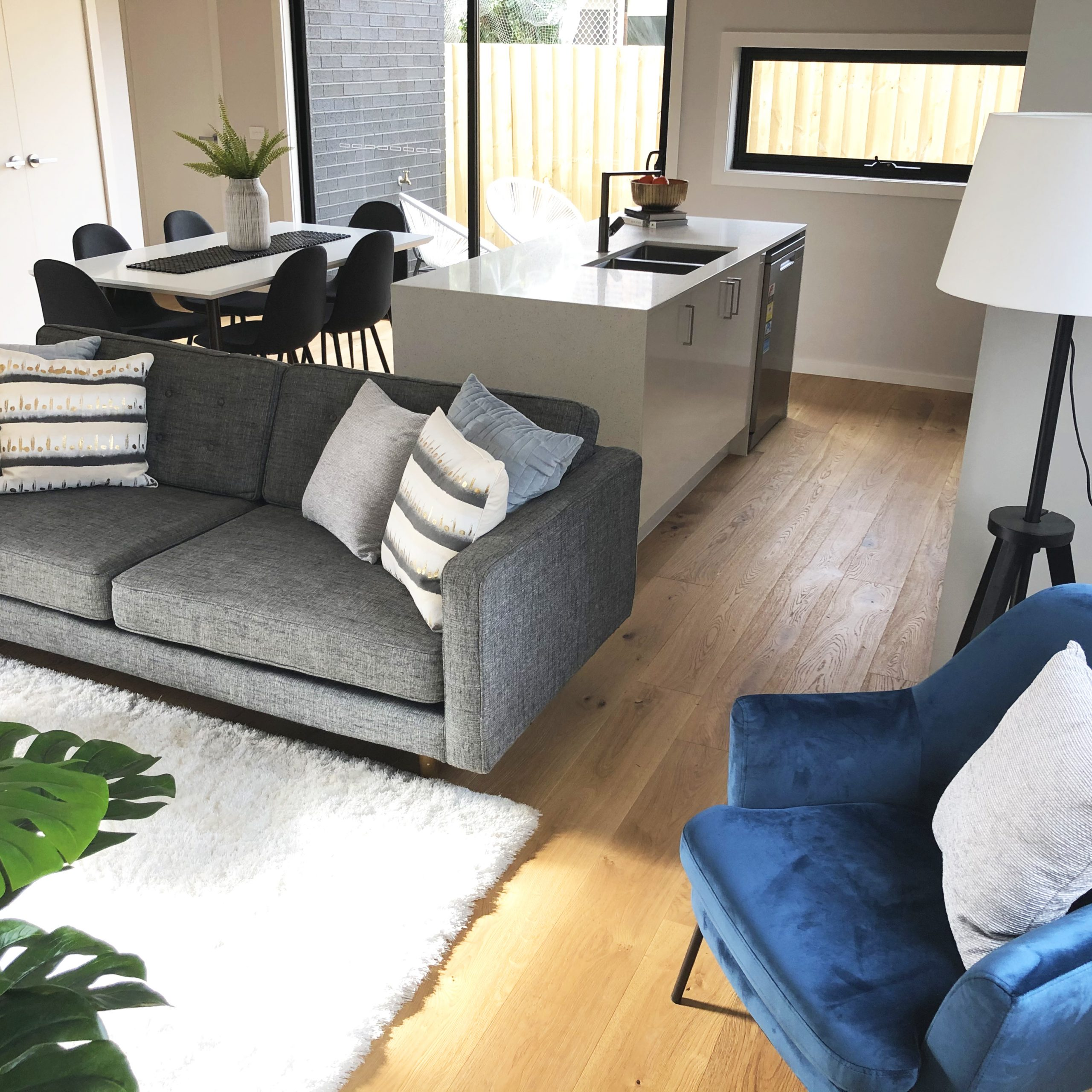 Styled living room with blue accents - Melbourne Property Styling - Leeder Interiors