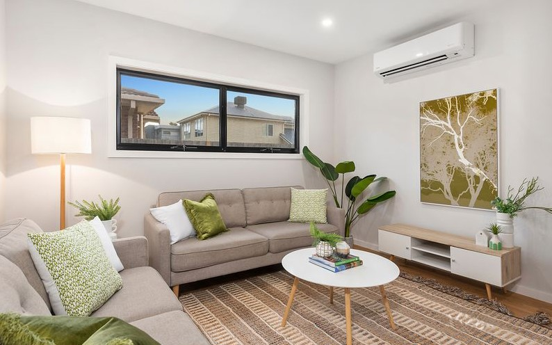Styled living room with green accents - Property Styling Melbourne - Leeder Interiors
