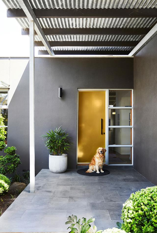 A mustard coloured front door on a grey home - Melbourne Interior Design - Leeder Interiors