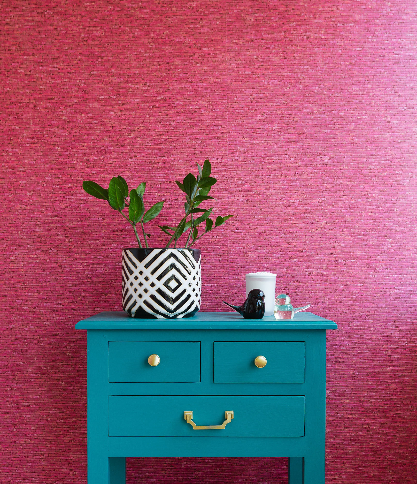 Colour of the moment...Teal A teal table against a pink wall.